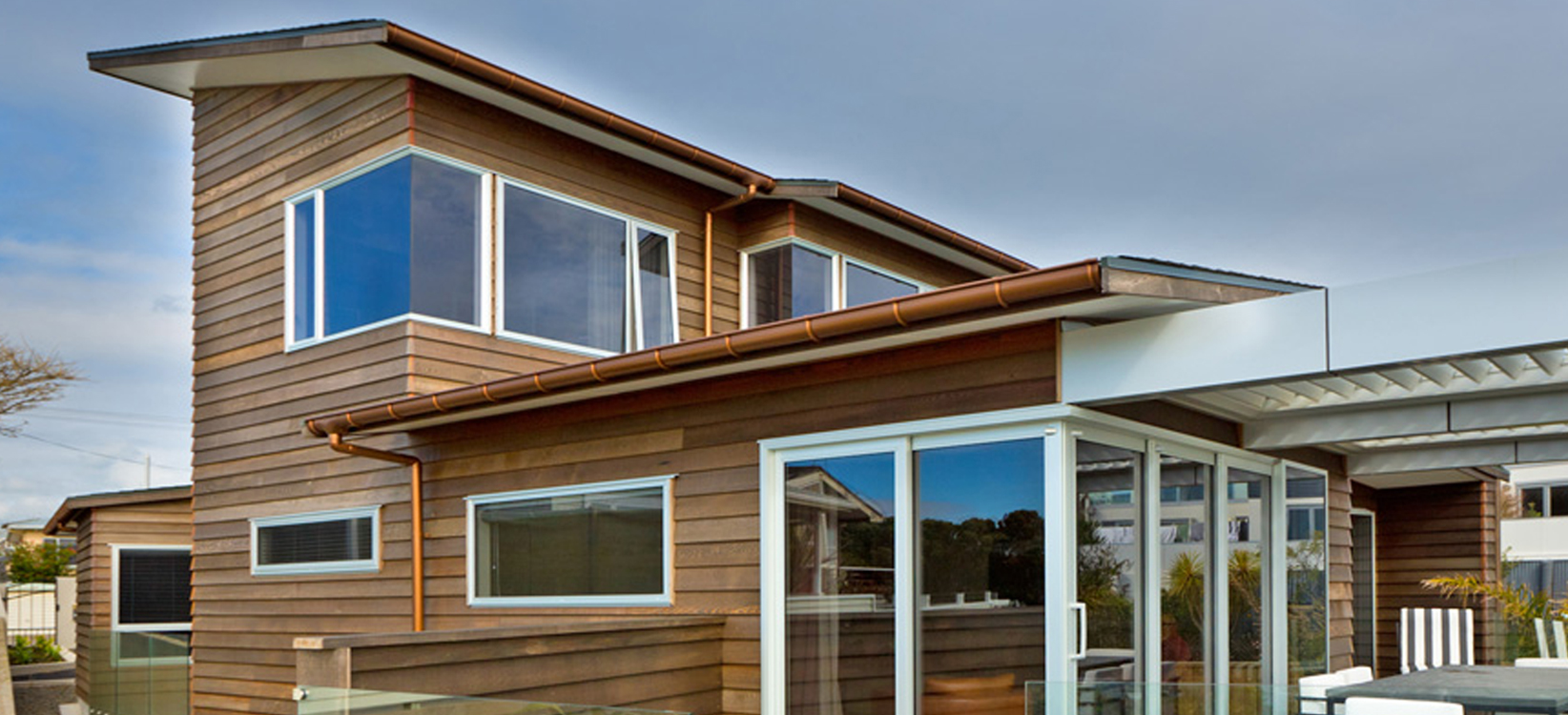 Cedar cladding home with Marley Typhoon copper spouting and RP80 downpipes