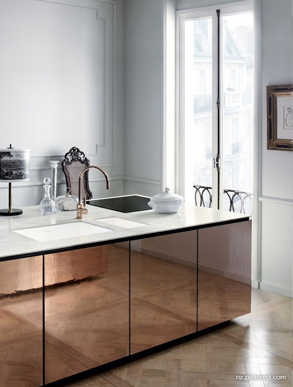 French kitchen with copper cabinets island and copper tapware